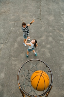 Top view with hoop of girls playing basketball