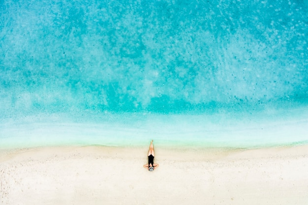 Top view of woman on the beach