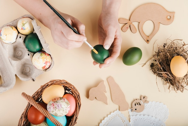 Top view of woman decorating easter eggs