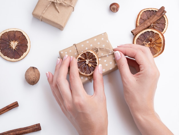 Top view of woman decorating gift boxes