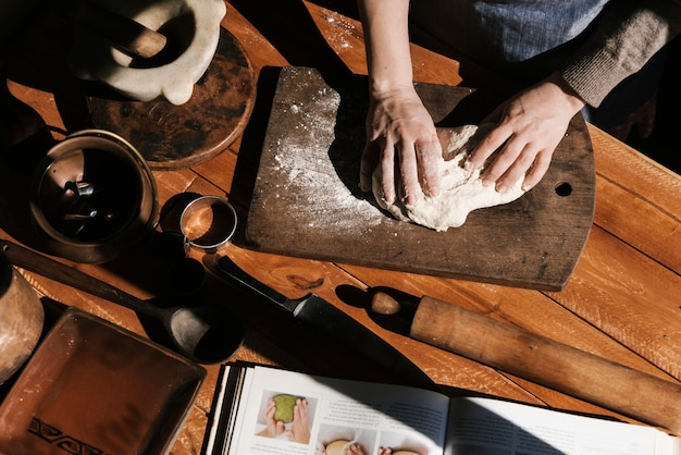 Top view of woman kneading dough