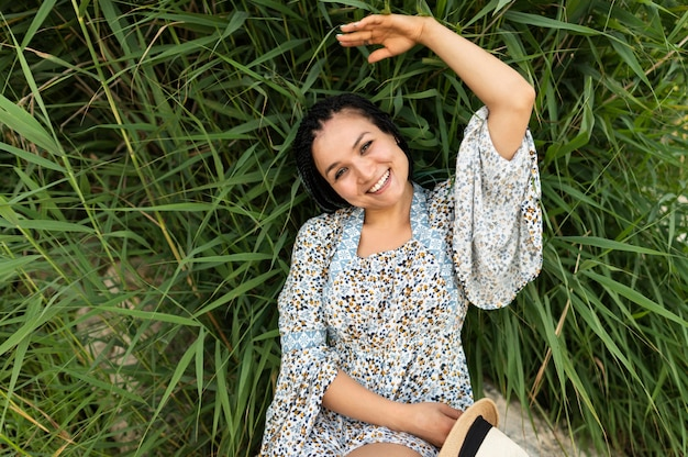 Top view woman laying on grass