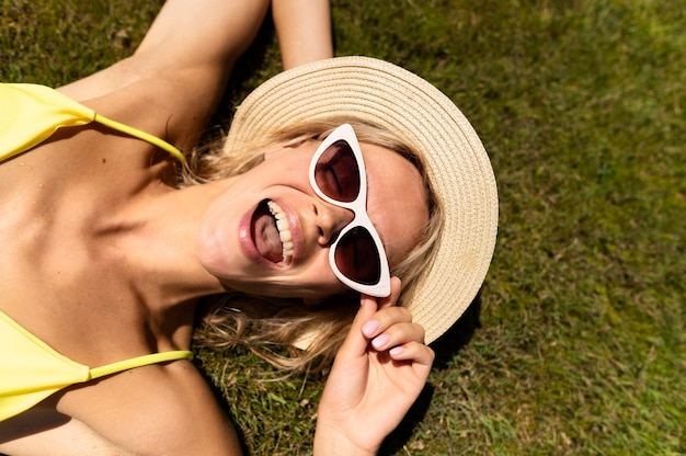 Top view woman laying on the grass