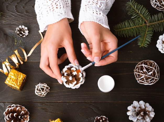 Top view of woman making christmas decorations