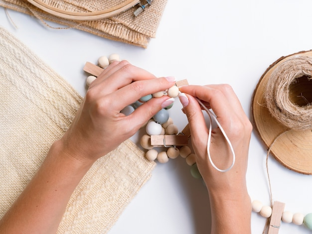 Top view of woman making wood decorations