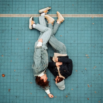 Top view woman and man lying on the floor