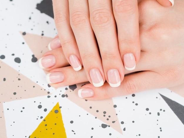 Top view woman's hands on geometric design Premium Photo