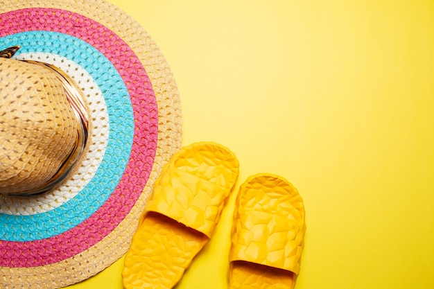 Top view of woman summer hat and slippers