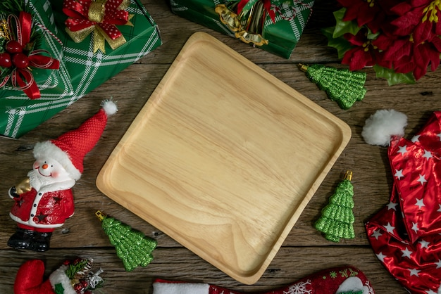 Top view, wood dish decoration with gift box and lights on happy new year day