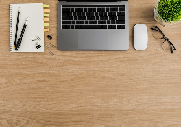 Top view wood office desk table. flat lay workspace