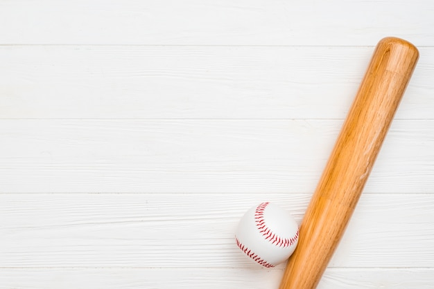Top view of wooden bat and baseball
