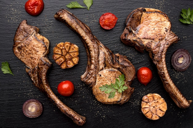 Top view wooden board with cooked meat