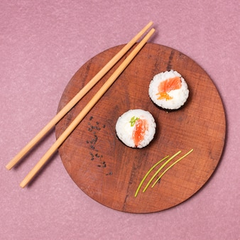 Top view wooden board with sushi