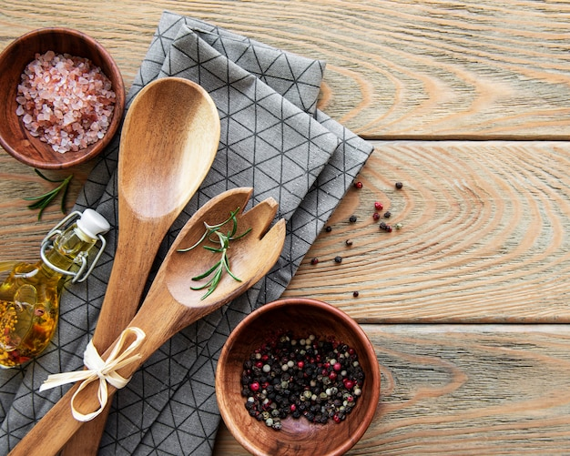 Top view on a wooden cutlery kitchen  ware on a  wooden table, flat lay