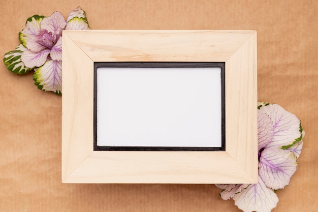 Top view wooden frame with flowers