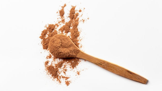 Top  view of wooden spoon with clay powder