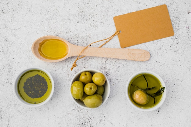 Top view wooden spoon with olives