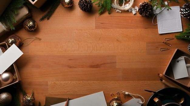 Top view of wooden table with copy space, mock up greeting card and decorations in christmas concept