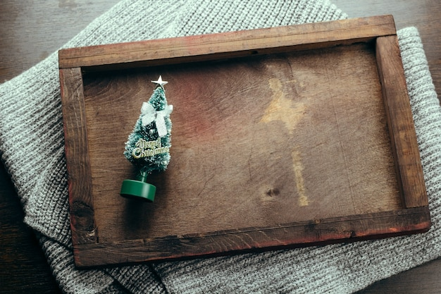Top view wooden tray with evergreen tree toy