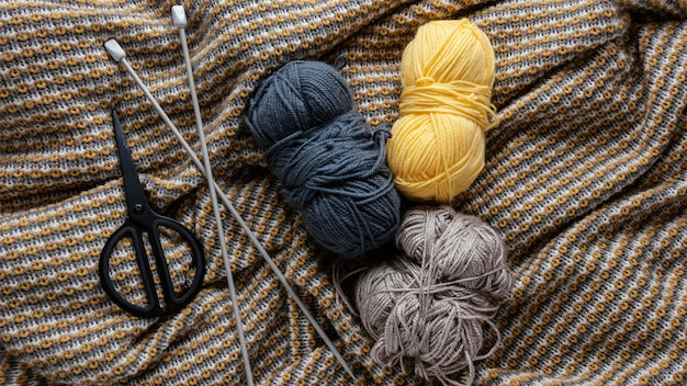 Top view wool and knitting needles