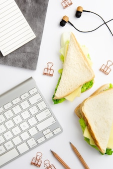 Top view working place with plate of delicious sandwiches