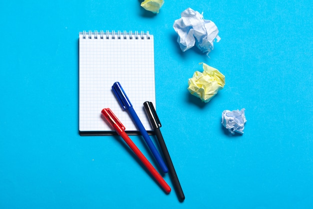Top view workspace mockup on blue background with notebook