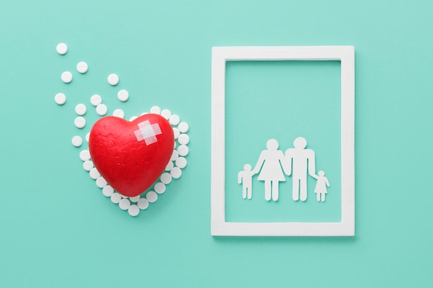 Top view world heart day concept with family frame