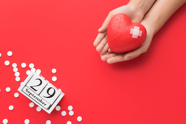 Top view world heart day concept with pills