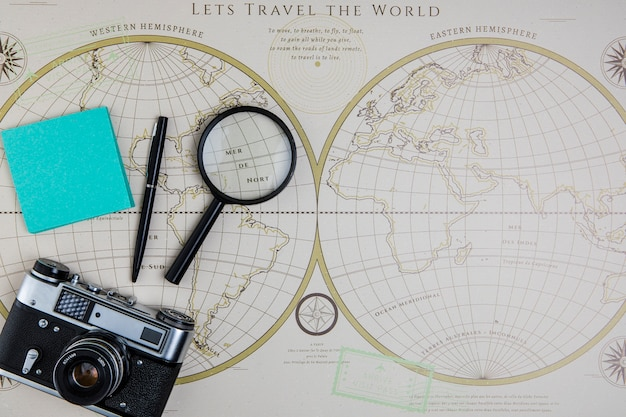 Top view world map and traveling tools