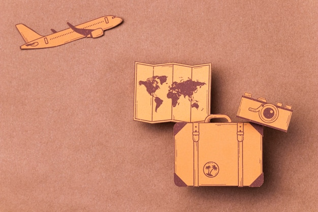 Top view world tourism day concept with luggage