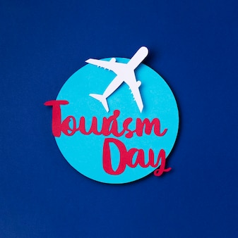 Top view world tourism day with lettering