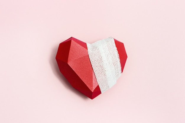 Top view of wounded red heart