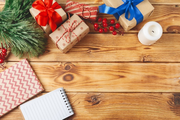 Top view of wrapped christmas gift boxes on wooden background