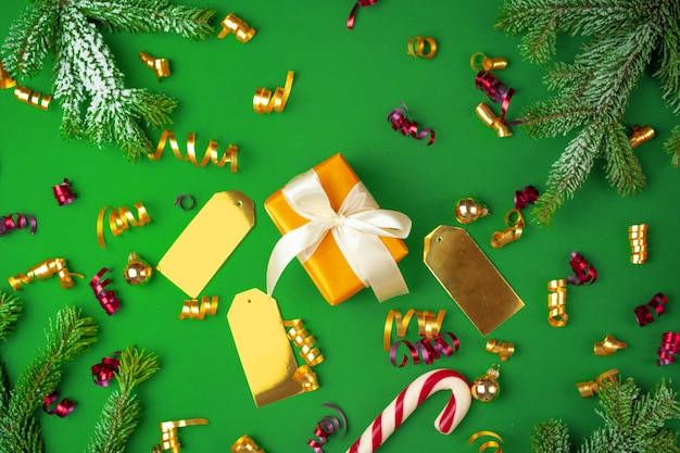 Top view of wrapped present on a green festive background