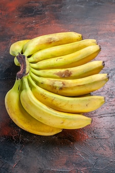Top view yellow bananas on dark background