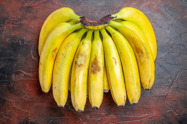 Top view yellow bananas on dark background