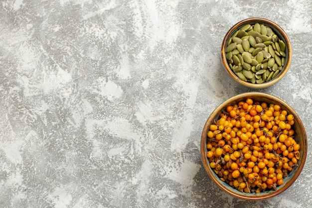 Top view yellow berries with green seeds on white background