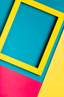 Top view yellow frame on colourful background
