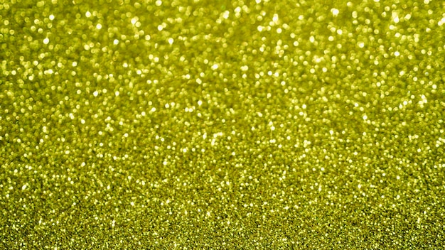 Top view yellow glitter background