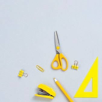 Top view yellow office supplies