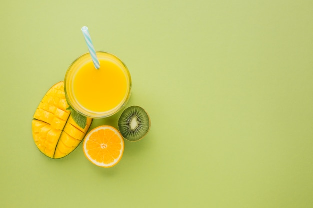 Top view yellow smoothie with copy space Premium Photo