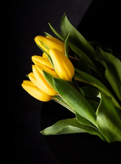 Top view yellow tulips on table