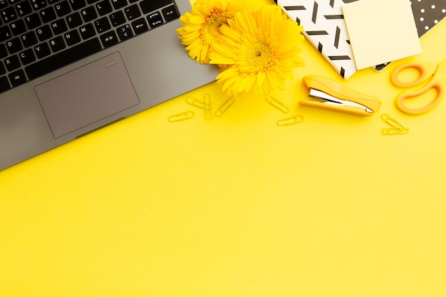 Top view yellow working desk with copy space