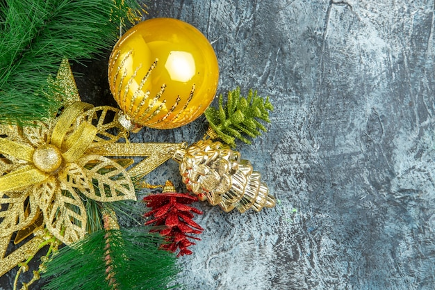 Top view yellow xmas tree ball xmas ornaments on grey background copy space