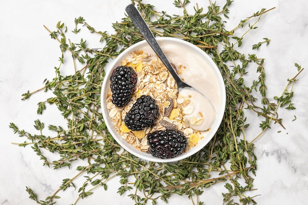 Top view yogurt with blackberries and oats