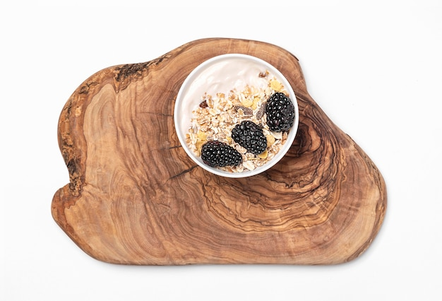 Top view yogurt with oats and blackberries