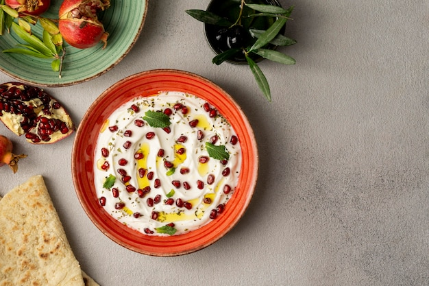 Top view of yogurt with pomegranate and oil