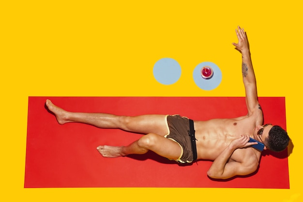 Top view of young caucasian male model's resting on beach resort