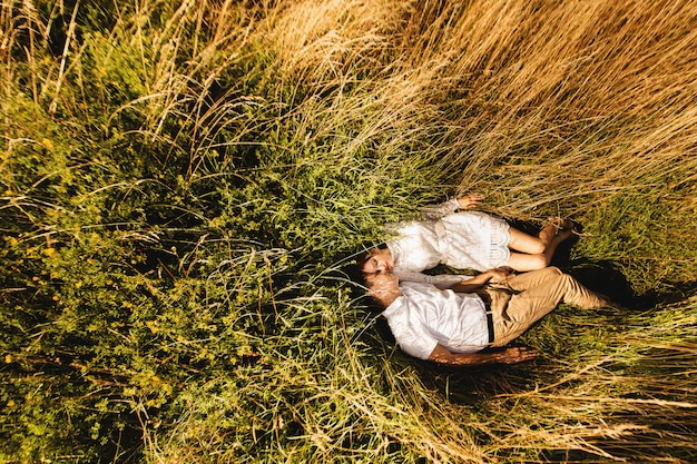 Top view. young couple lying in the grass and enjoys nature