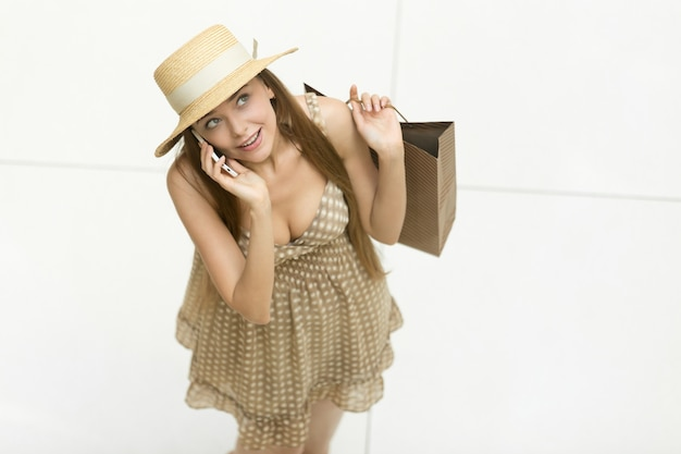Top view young girl with a straw hat